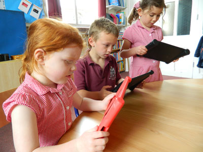 Primary school children using tablets